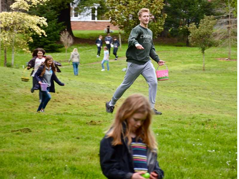 COURTESY PHOTO - Teen members of Hands Helping Hands enjoy an Easter egg hunt at Willamette Park.