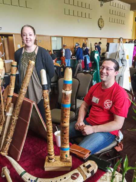 Kyle Neidig (R) discusses sone of his hand-made wind instruments with Mikaela Shrumm (L) at last year's exhibit.