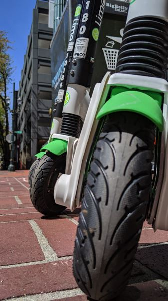 FILE PHOTO - A close-up of Lime electric scooters is shown here.