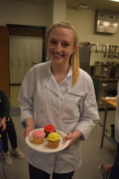 PMG PHOTO: RAYMOND RENDLEMAN - Clackamas High School sophomore Rachel Zitzelberger holds some cupcakes she made as a North Clackamas student attending the districts first culinary Industry Day on April 18.