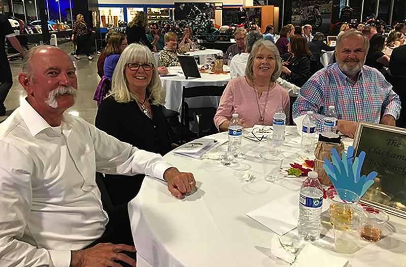 COURTESY PHOTO: LESLIE ROBINETTE - Representatives of the Clackamas Bookshelf share a fun evening at the Gladstone Education Foundation Dinner & Auction.