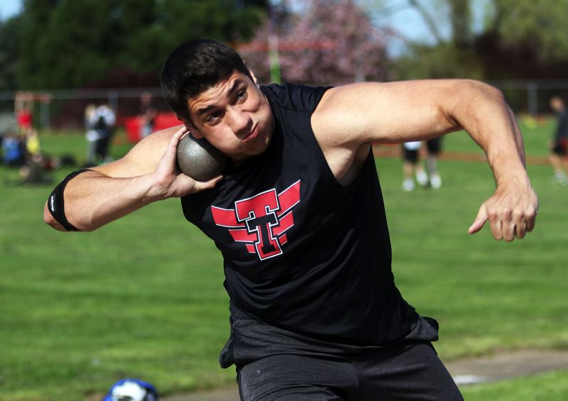 PMG PHOTO: DAN BROOD - Tualatin High School senior Nano Kis gets ready to throw the shot put during the Wolves' Three Rivers League meet with Oregon City and West Linn.