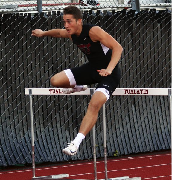 PMG PHOTO: DAN BROOD - Tualatin High School junior Luke Marion ran to victory in the 110-meter high hurdles event during the Wolves' league meet with Oregon City and West Linn.