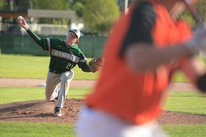 PMG PHOTO: DAVID BALL - Estacada starter Conor McNulty deals a throw to the plate during the first inning of Mondays 10-0 road loss at Gladstone.