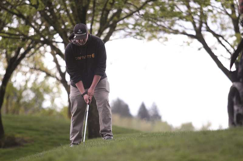 PMG PHOTO: PHIL HAWKINS - North Marions Jakob Null prepares to chip onto the green at the April 16 Husky Invitational, where he shot a competitive best score of 103.