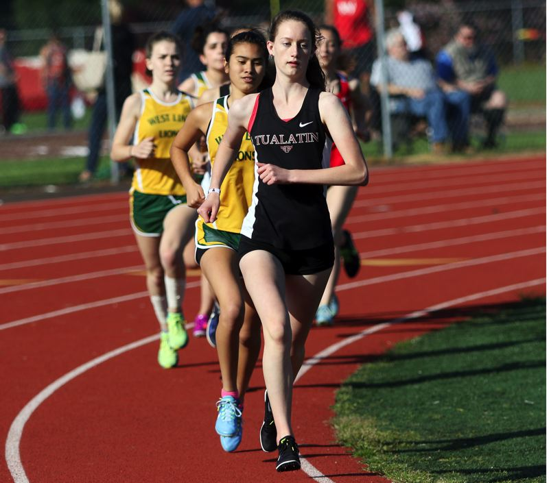 PMG PHOTO: DAN BROOD - Tualatin High School junior Kaitlyn Gearin leads the pack in the early going of the 1,500-meter run during last week's double dual meet.