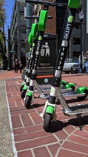 FILE PHOTO - Lime scooters were the firston the streets of Portland on Friday, having been awarded a license by PBOT. They are joined by Bolt and Spin, both of which are new to Portland.