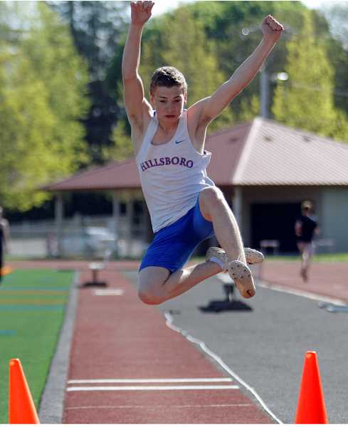 PMG PHOTO: WADE EVANSON - Hillsboro High School's Cole Stokes competes in the long jump at last week's Elden Kellar Invitational Friday, April 26, at Hare Field.