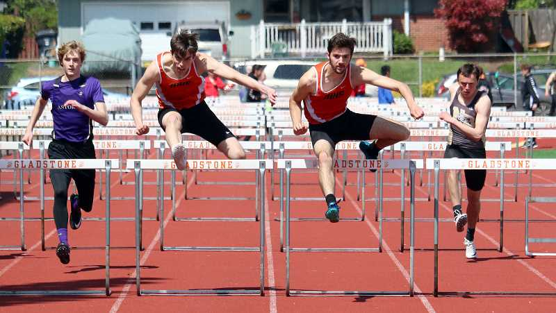PMG PHOTO: JIM BESEDA - Molalla's Nick Lucas was named the Outstanding Male Athlete at the 14th Dick Baker Invitational track and field meet Saturday at Gladstone High School. Lucas won the 110-meter high hurdles in a personal best 15.45 seconds, edging teammate Michael House by 16-hundredths of a second.