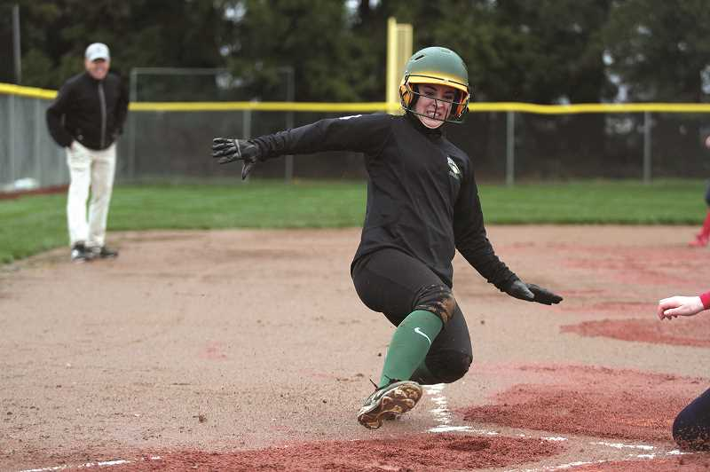 PMG FILE PHOTO: PHIL HAWKINS - Colton's Madison Olsen slides across home plate to score for the Lady Vikings.