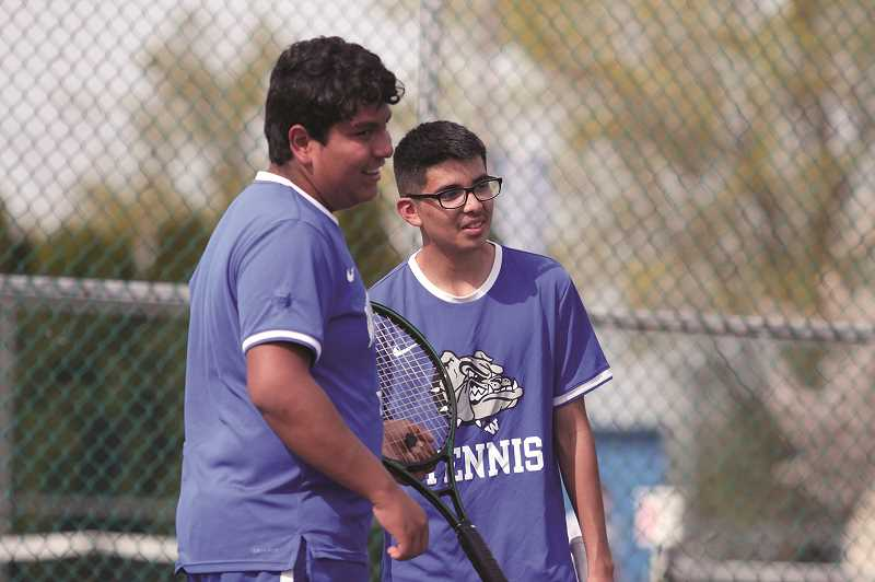 PMG PHOTO: PHIL HAWKINS - Woodburn teammates Bryan Gomez and Juan Alfaro won the boys tennis teams first doubles game of the season last week, beating the No. 1 team from Stayton 7-5, 7-6.