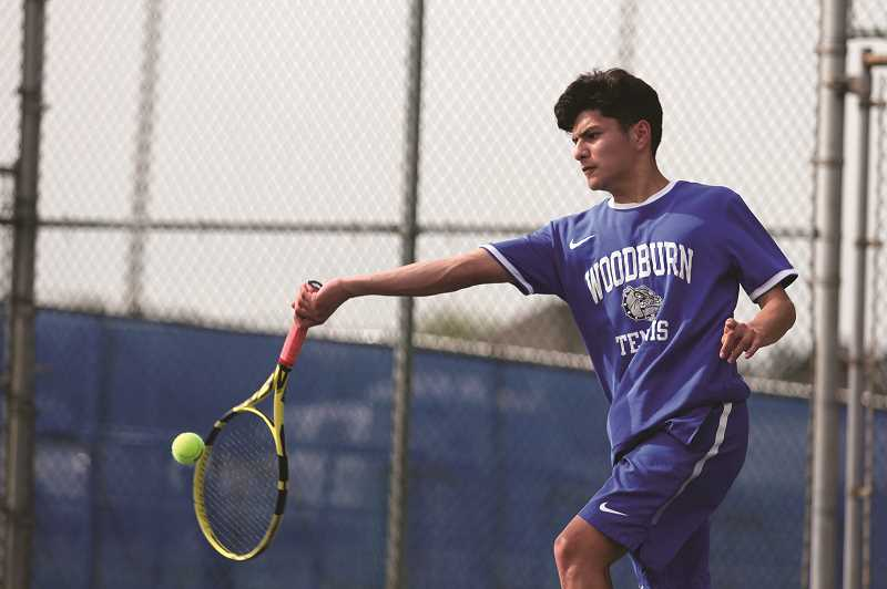PMG PHOTO: PHIL HAWKINS - Woodburn's top singles player, sophomore Jonathan Swenson, will enter the district tournament as a top four seed and is the Bulldogs top contender to qualify for the state tournament this year.