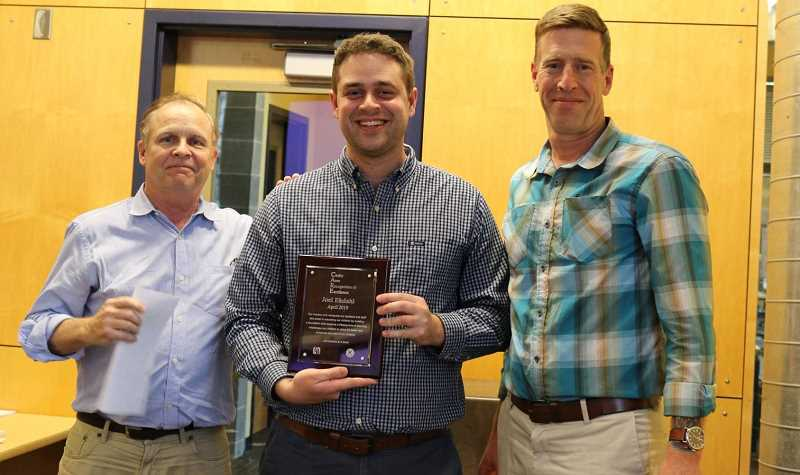 CANBY SCHOOL DISTRICT - The latest CARE Award winner, Canby High English teacher Joel Ekdahl (center) receives his award flanked by CHS Principal Greg Dinse (right) and Canby School District Superintendent Trip Goodall.