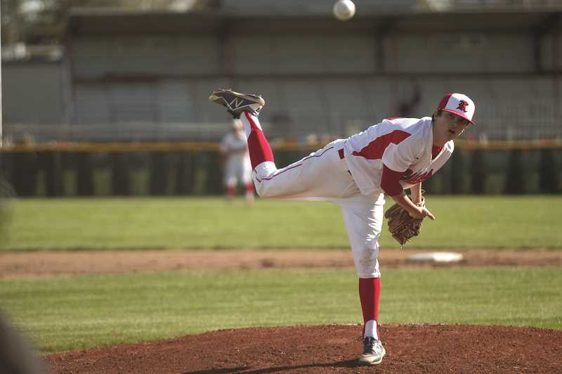 PMG FILE PHOTO: PHIL HAWKINS - Kennedy sophomore Dylan Kleinschmit gave up zero hits, walked two batters and struck out 17 in the No. 2 Trojans' 1-0 win over the No. 9 Santiam Wolverines on April 23.