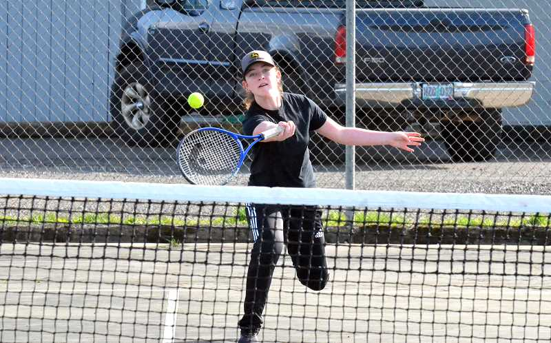 PMG FILE PHOTO: TANNER RUSS - Country Christian and Molalla athlete Allison Burruel returns a volley.