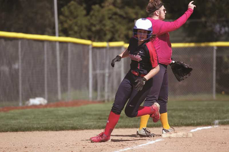 PMG PHOTO: PHIL HAWKINS - Kennedy sophomore Kelsey Kleinschmit rounds third base as part of the Trojans' 14-run second inning against the Sheridan Spartans on April 24.