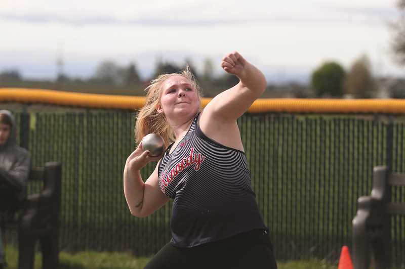 PMG PHOTO: PHIL HAWKINS - Kennedy senior Makayla Massey finished second in the shot put and first in the discus to lead the Trojans in the throwing events at the teams home meet last week.