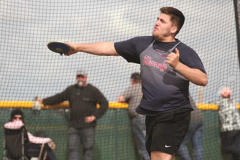 PMG PHOTO: PHIL HAWKINS - Senior Nick Suing took first place in the discus and shot put, joining teammates Luke Hall and Carlos Saravia in winning two events at home.
