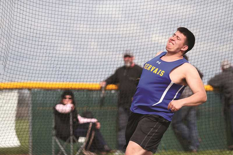 PMG PHOTO: PHIL HAWKINS - Gervais senior Alejandro Contreras set a new PR in the discus of 98-10 to finish runner up in the event.