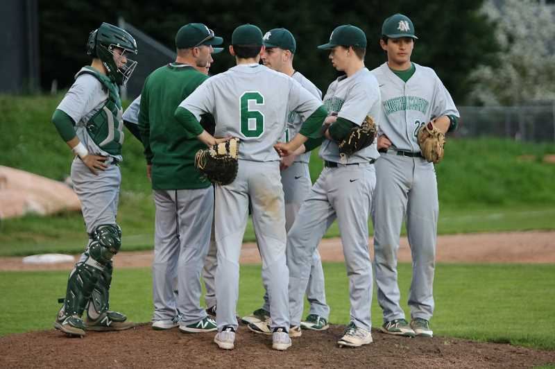 PMG PHOTO: JIM BESEDA - North Marion talks strategy in the fifth inning from the mound.