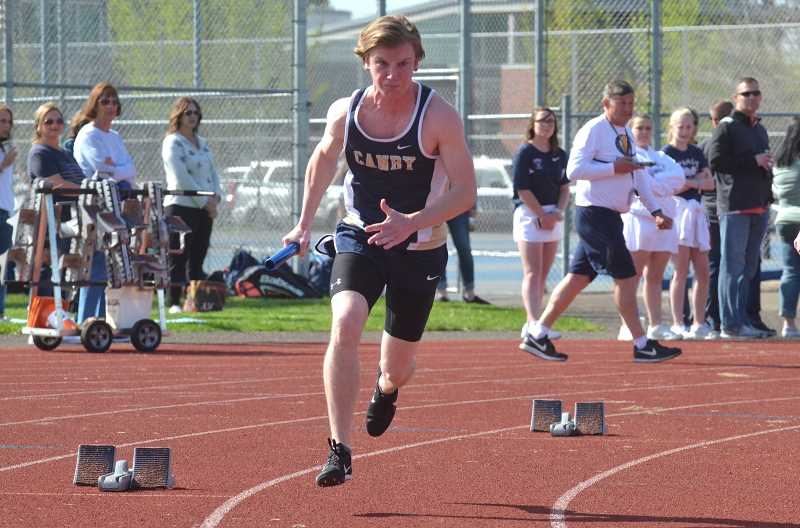 PMG PHOTO: TANNER RUSS - Canby sprinter Tucker Goode leads off the 4x100-meter relay.