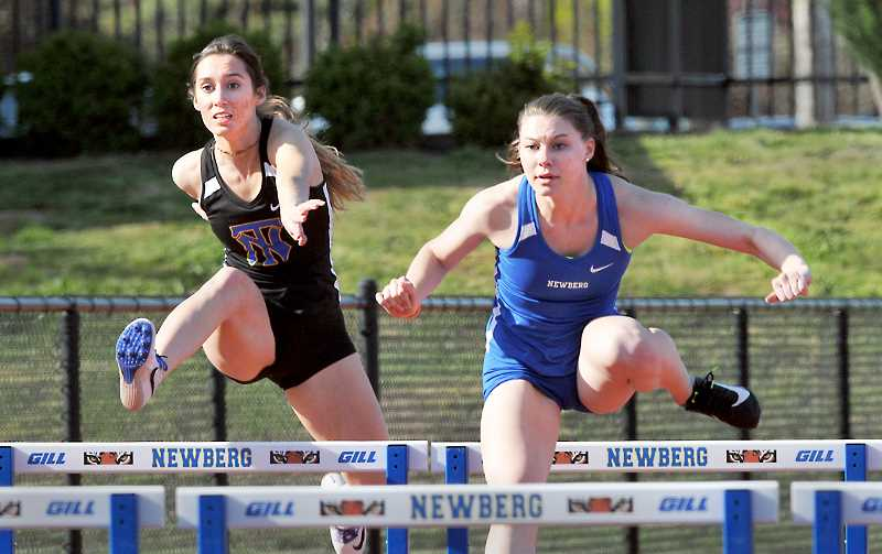 GRAPHIC PHOTO: GARY ALLEN  - Juniors Rilee Carstensen and Karly Fouche finished second and fourth, respectively, in the high hurdles in the Tigers' dual meet against Glencoe. Carstensen's time of 16.05 seconds was a personal record.