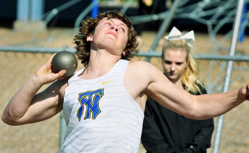 GRAPHIC PHOTO: GARY ALLEN  - Senior Elijah Woody had a strong day in the shot put, hurling it more than 45 feet, which is his career-best mark.