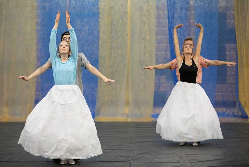 PMG PHOTO: JONATHAN HOUSE - From left, Devyn Jacobson, Mack Castaneda, Cole Goodheart, and Olivia Reynolds perform a dance routine during rehearsal for West Linn High's May Day.