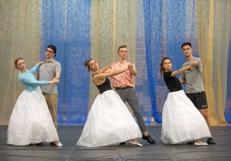 PMG PHOTO: JONATHAN HOUSE - From left, Devyn Jacobson, Mack Castaneda, Olivia Reynolds, Cole Goodheart, Faith Varga, and Cade Knutson perform a dance routine during rehearsal for West Linn High's May Day.