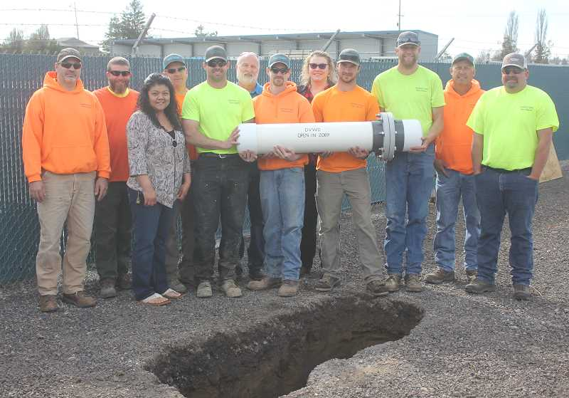 DESIREE BERGSTROM/MADRAS PIONEER - DVWD staffers gather for the time capsule event.