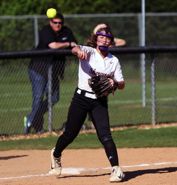 PMG PHOTO: DAN BROOD - Sherwood freshman third baseman Ary Koskey makes a throw to first base to complete a double play in the Lady Bowmen's 22-5 win over Sprague.