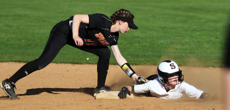 PMG PHOTO: DAN BROOD - Sherwood High School junior Jordyn Moullet-Dozier (right) is safe to second on a stolen base attempt during the win over Sprague on Monday.