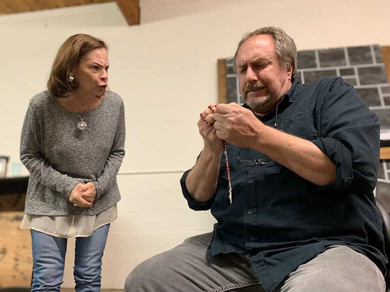 PMG PHOTO: JANAE EASLON - Donna Haub and Steve Koeppen perform in Mask and Mirror Community Theatre's 'The Butler Did It!'