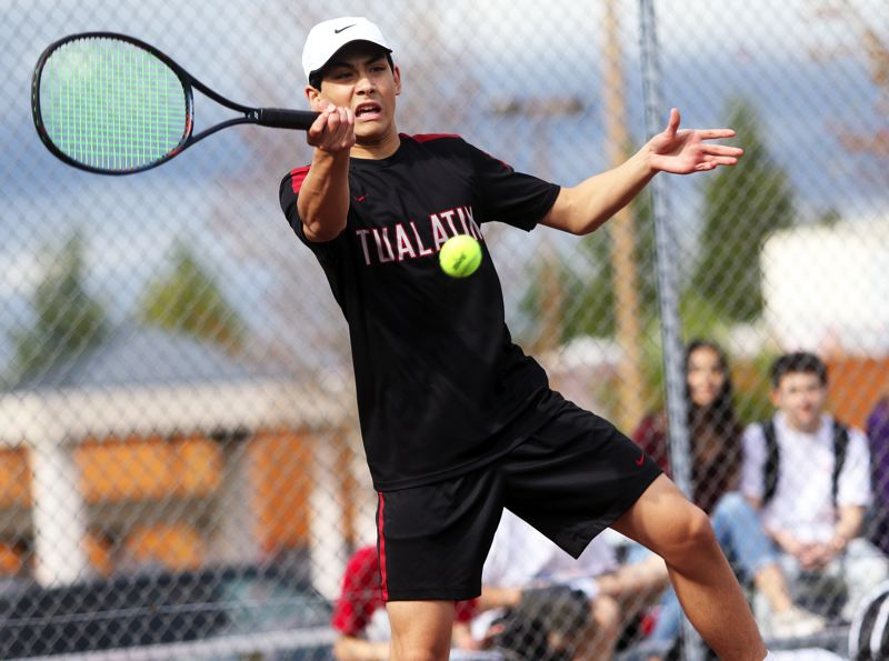 PMG PHOTO: DAN BROOD - Tualatin's Andrew Monkarsh hits a shot during the No. 1 singles match when the Timberwolves hosted Tigard.