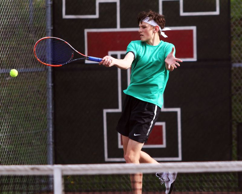 PMG PHOTO: DAN BROOD - Tigard High School senior Connor Ciula hits a forehand shot during No. 1 doubles play in the Tigers' win at Tualatin.