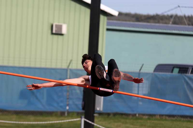 STEELE HAUGEN - Culver's Kash Michael jumps a personal best in the high jump (6-04) and claims gold in the process.