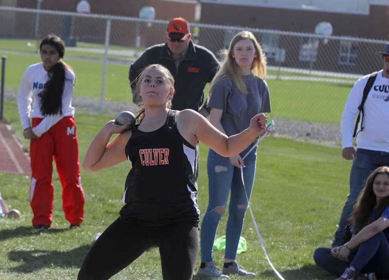 STEELE HAUGEN - Talyn Barry throws the shot put at the Madras meet April 24, claiming gold.