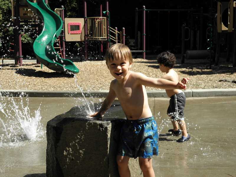 COURTESY PHOTO  - The splash pad at Robinwood Park is a popular spot during summer.