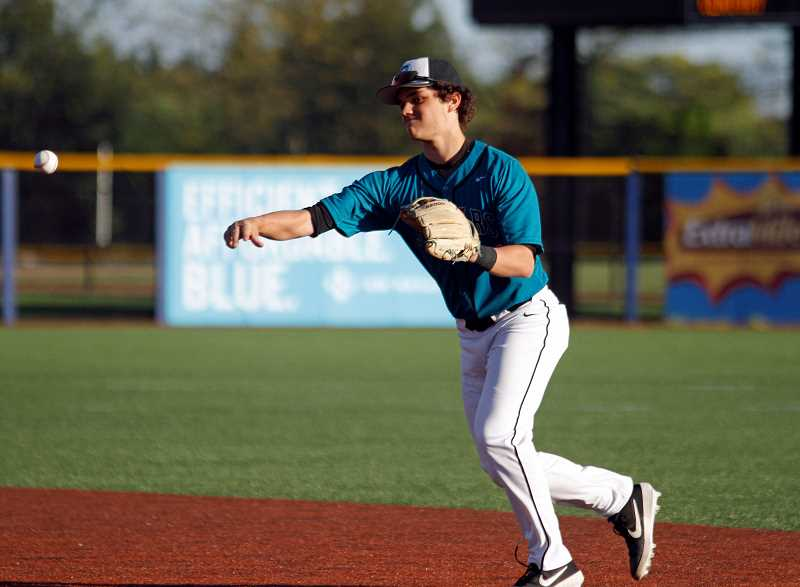 PMG PHOTO: WADE EVANSON - Century's Jared Gordon makes a play from second base during the Jaguars' game against McMinnville Tuesday, April 30, at Ron Tonkin Field in Hillsboro.