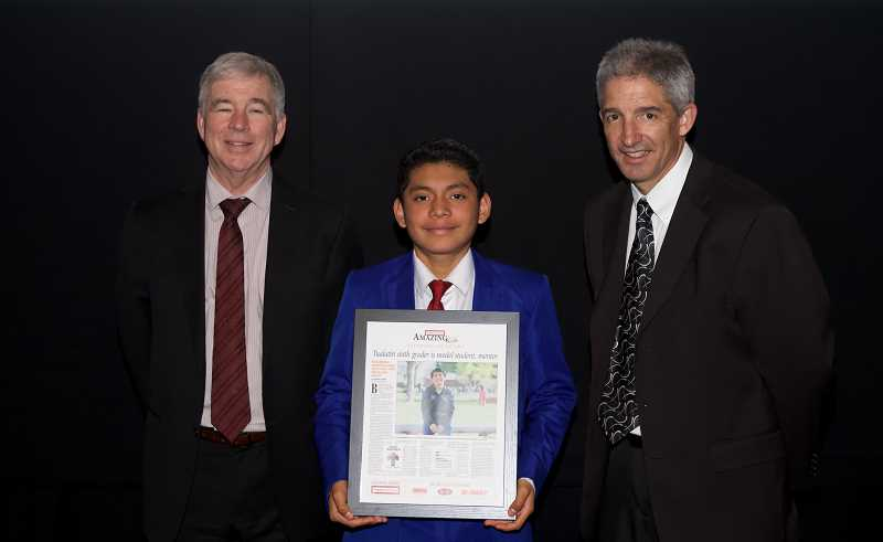 TIMES PHOTO: JAIME VALDEZ - Tualatin's Bryan Mendez Cordero was recognized as an Amazing Kid Monday during an awards presentation at the Oregon Museum of Science & Industry. The awards were presented by Pamplin Media Group President Mark Garber, left, and Pamplin Media Group Vice President J. Brian Monihan.