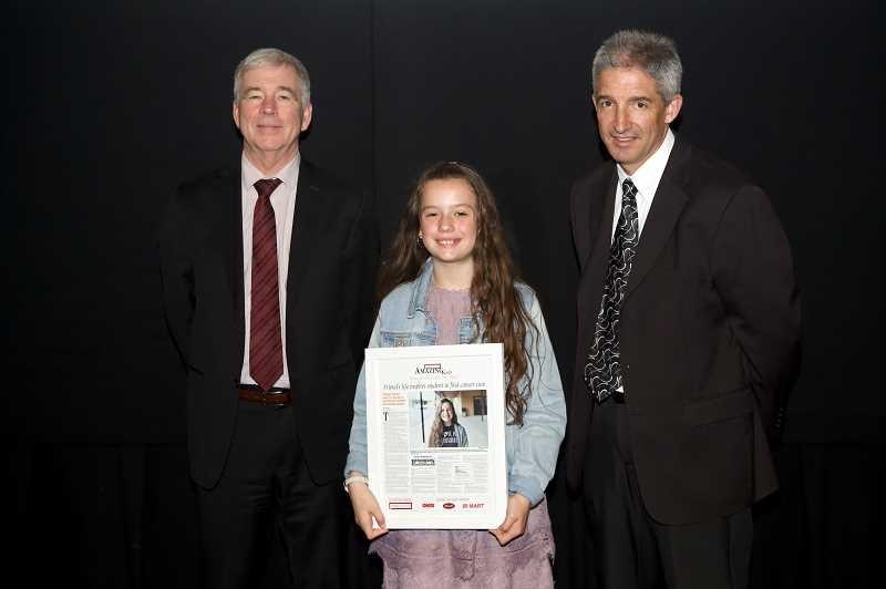 TIMES PHOTO: JAIME VALDEZ - Calleigh Germer, a Twality Middle School sixth-grader, was recognized as Tigard's Amazing Kid Monday during an awards presentation at the Oregon Museum of Science & Industry. The awards were presented by Pamplin Media Group President Mark Garber, left, and Pamplin Media Group Vice President J. Brian Monihan.