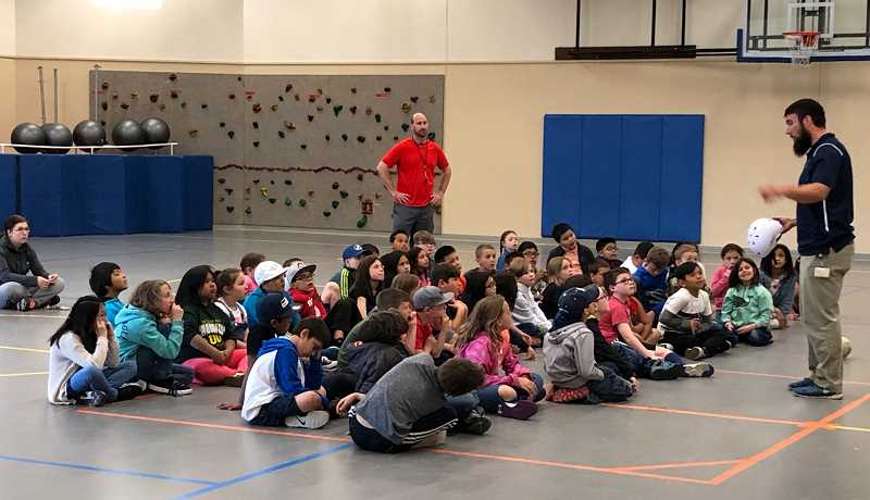 SUBMITTED PHOTO - Third graders at Buff Elementary listen to a helmet safety program presented by the Center Foundation. The students learned how to properly put on a helmet, and, with the help of dropped melons, saw how important a helmet is for head safety.
