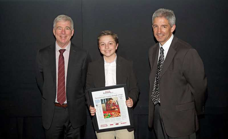 TIMES PHOTO: JAIME VALDEZ - Holden Goyette, 13, a Laurel Ridge Middle School student, was recognized as Sherwood's Amazing Kid Monday during an awards presentation at the Oregon Museum of Science & Industry. The awards were presented by Pamplin Media Group President Mark Garber, left, and Pamplin Media Group Vice President J. Brian Monihan.