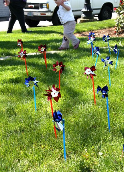 PMG FILE PHOTO - A toddler walks past pinwheels displayed to represent the number of Columbia County children in foster care. State panels are coming up short in their search for solutions to recent foster care problems.