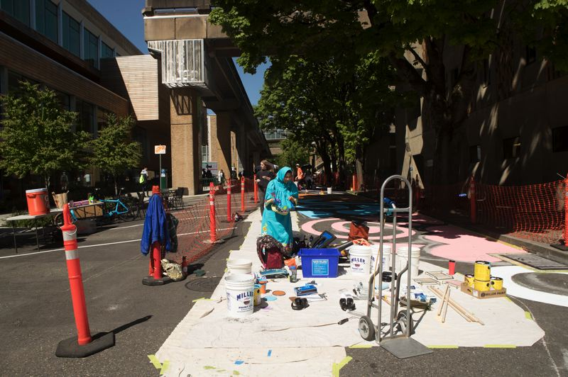 PAMPLIN MEDIA GROUP: JAIME VALDEZ - The Montgomery Pop-Up Plaza at Portland State University opened on Wednesday May 1, 2019. Here painters put the finishing touch to the street painting. Street Seats will be installed and vehicles kept out by planters.