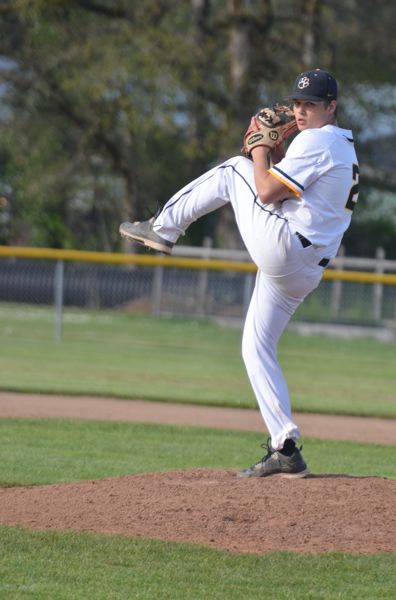 COURTESTY PHOTO: JOHN BREWINGTON - Drew Sullivan pitches for St. Helens as the Lions defeat Scappoose 3-1 in their series finale last week to win the series 2-1.