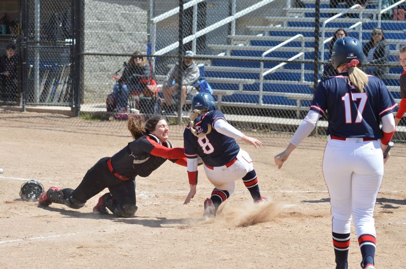 COURTESY PHOTO: JOSH RANDOLPH/9INNINGKNOWITALL.COM - Mt. Hood Community College catcher Hadley Enos, a freshman from Scappoose High, applies the tag to a Lower Columbia runner during a road game last week.