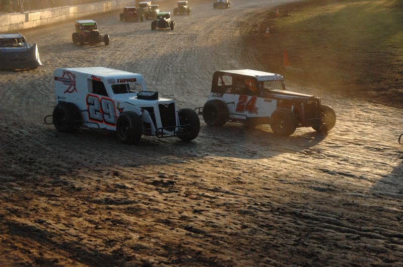 COURTESY FILE PHOTO: MIKE WEBER - Dennis Liebig (right) and Jake Tupper, two drivers from Scappoose, battle in a Labor Day weekend Dwarf Car Division race last year at River City Speedway.