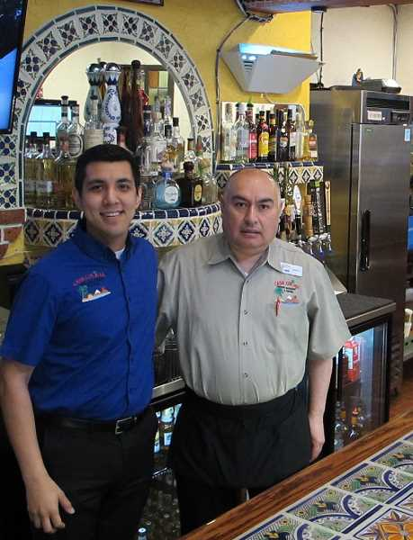 Ochoa and bar manager Sergio Garcia , who has been serving drinks at Casa Colima since 2004.