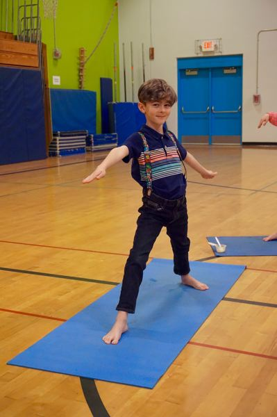 PMG PHOTO: CLAIRE HOLLEY - Hallinan student Isaac Silver demonstrates his best warrior pose.